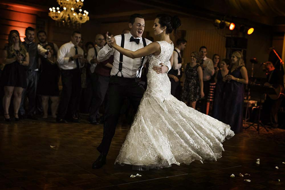 Wedding couple performing a swing dance routine to the music of the Long Island Jazz Orchestra