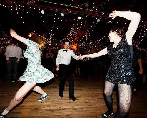 Two young woment enjoying swing dancing.